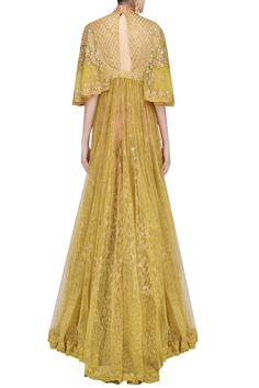 Description Featuring a yellow floor length trail gown in net base flare and raw silk bodice embroidered with floral thread and zardozi work all over the front and back. It has heavy embroidered cape sleeves along with loop button closure detailing on the front. It is paired with pink embroidered raw silk pants. FIT: Fitted at bust and waist. COMPOSITION: Raw silk, net.