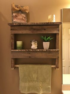 The Best DIY Wood and Pallet Ideas: Rustic bathroom shelf with towel hanger
