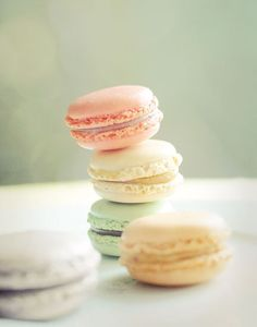 Green, peach, yellow, and white macarons