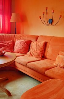 The hue in this room is orange. I have asked my mom why we can't get a cool colored couch- this is why.