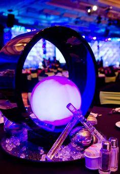 Wedding reception decor featuring incredibly dramatic futuristic sci-fi orb table centerpieces.