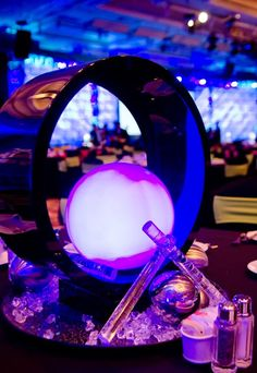 Wedding reception decor featuring incredibly dramatic futuristic sci-fi orb table centerpieces.