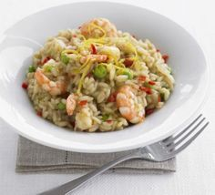 Lemony shrimp & pea risotto: shrimp, optional chili or other pepper, fish stock or other stock or water, butter or oil, rice or favorite grain, white wine, peas lemon