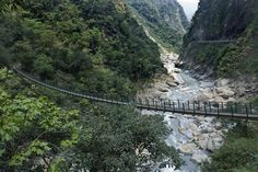 """""""At Taroko National Park in Taiwan is a narrow suspension bridge that hangs across the river in a steep marble canyons. Crossing it isn't for the faint-hearted, but brave the trip if you wish to get good photo of the area. The parkwith its spectacular 19km-long landmark gorge has breathtaking rugged cliffs, cascading streams and caves."""" via http://www.tripbucket.com"""