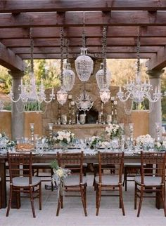 These beautiful chandeliers give a whole new meaning to outdoor dining...