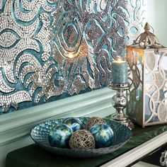 Love the mosaic done with the mirror tile pieces. Would like to try doing something similar. Like the collection along w/the Peacock Serving Bowl | Pier 1 Imports