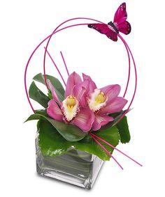 The perfect gift for the mother who loves orchids, these facinating pink cymbidium orchids are sure to delight! Designed atop a clear glass cube, this cool and trendy design is not only whimsical and fun, but also totally unique! Contemporary Flower Arrangements, Small Flower Arrangements, Ikebana Flower Arrangement, Orchid Arrangements, Flower Vases, Deco Floral, Arte Floral, Mothers Day Flowers, Valentine Flowers