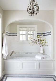 Dazzling tub enclosures in Bathroom Traditional with Alcove Tub next to Tiles Around Tub alongside Tile Bathtub Surround and Paint Wood Paneling Bad Inspiration, Bathroom Inspiration, Dream Bathrooms, Beautiful Bathrooms, White Bathrooms, Master Bathrooms, Small Bathrooms, Master Bedroom, Tile Around Tub
