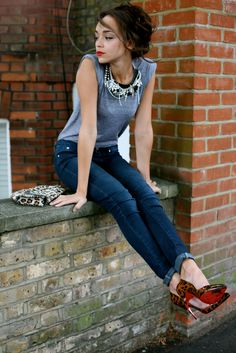 accessories make the look: basic jeans and grey tee paired with leopard heels, leopard clutch and a rhinestone statement necklace
