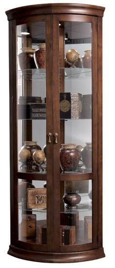 Howard Miller Chancellor Corner Curio Cabinet in Hampton Cherry lines, looks good Corner Display Cabinet, Corner Curio, Tall Cabinet Storage, Glass Curio Cabinets, Crockery Cabinet, Glass Shelves, Cabinet Furniture, Dining Furniture, Furniture Decor