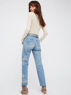 Heirloom Paisley Jean | Made from hand selected vintage denim featuring original distressing and natural wear and tear, these boyfriend fit jeans feature beautiful embroidery detailing.      * Authentic, non-stretch denim.    * Five-pocket style.    * Button fly.    * Due to the use of vintage materials each pair will vary slightly.