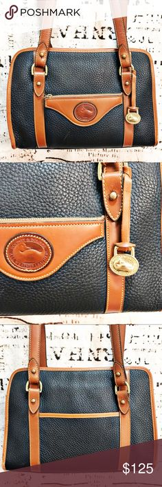 Dooney & Bourke Vintage Navy Tan Pebbled Purse This bag by Dooney & Bourke is classic and beautiful. Navy and British Tan in color, this bag features dual shoulder straps, front zip pocket with D&B logo, large D&B hanging gold-toned charm, open back pocket. Immaculate interior with side zip pocket. Minimal wear, all documented in photos - small mark across front leather, slight wear of brown edging where bag rests when set down, and small pen mark on one strap. In overall incredible…