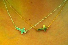 sweet sideways cross necklaces in gold and silver https://www.facebook.com/riverroadpharmacyandgifts