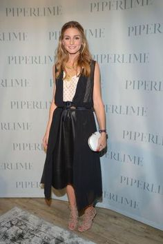 Olivia Palermo in a belted midi leather skirt outfit