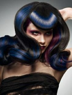 I love how the blue color looks like a light hitting the hair!  Great retro styling too!!