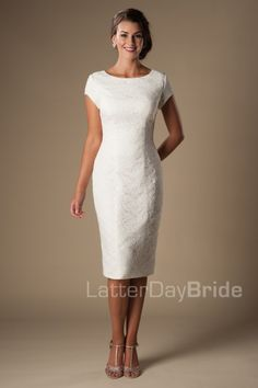 Audrey | Modest Wedding Dresses | Sleeves | LatterDayBride & Prom | SLC | Utah | Worldwide Shipping | LDS Bridal Gowns |  You've found your perfect tea length modest wedding dress. Sophisticated and classy, this lovely wedding gown features a delicate lace pattern and a flattering bateau neckline.     Gown available in Ivory or White    *Gown pictured in Ivory
