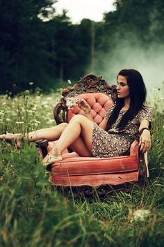 Love photography with furniture in the middle of a field.