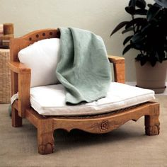 """Raja Chair With Cushion - Raja means """"royalty"""" in Hindi. Shorter-styled armrests provide comfort in any sitting position, especially cross-legged sitting or meditation. Crafted from woven banana leaves and sustainable, plantation-grown mango wood from fruit-bearing trees, each piece of this chair is kiln-dried and protected with a natural water-based finish. Cushions are filled with kapok, a cotton-like fiber from the fruit of the Asian kapok tree."""