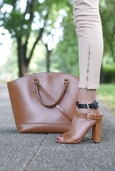 Neutral shoes, bag and pants.