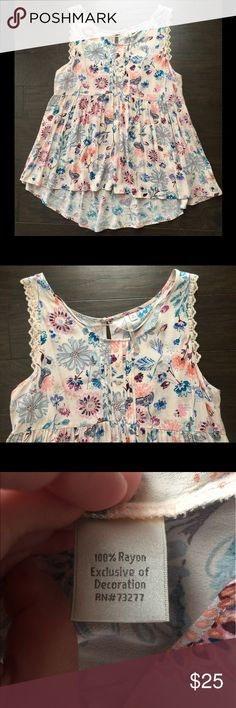 Top by LC Lauren Conrad This is an incredibly cute tank top by LC Lauren Conrad from Kohls. It is high/low style & flowy. Only worn once. Size XL. LC Lauren Conrad Tops Tank Tops
