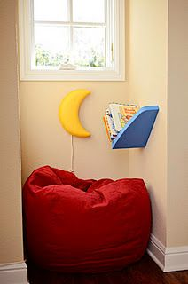 reading nook in a playroom; book shelf & moon light from IKEA