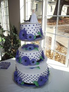 This is cool with the polka dots and a wedding topper. I like the colors but would do the colors to match ours. the flowers could be better.