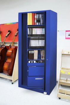 Pick me! is the new teacher's pet for music storage and more. This rotary cabinet holds sheet music, lesson plans, student records and small instruments. Tall Cabinet Storage, Locker Storage, Stow Away, Lateral File, New Teachers, Music Education, Cabinet Design, Space Saving, Lesson Plans