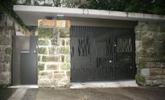incredible automated laser cut screen for a residential garage door!