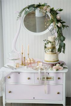 Chic dresser covered in flowers and leaves to create a simple yet elegant dessert table - love! #weddingdessert #wedding #desserttable #vintage #shabbychic