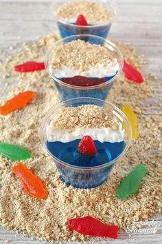 Day at the Beach Jello Cups are perfect for a summer party. The best part is once everyone is done eating the yummy treat, you can just throw away the dishes! Try them for your next luau or pool party. #PoolParty #EasyDessert #Jello