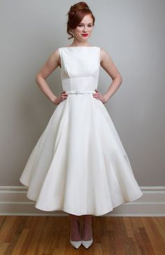 Linda - Vintage Inspired Tea Length Wedding Dress - Evoke the details of the mid century with Fancy Bridal NY most iconic dress Linda. A vintage inspired tea length wedding dress, with its empire waist line and flared skirt that creates the perfect silhouette for all sizes. Made of Silk Mikado or Poly Taffeta includes the belt. . - http://fancybridalny.com
