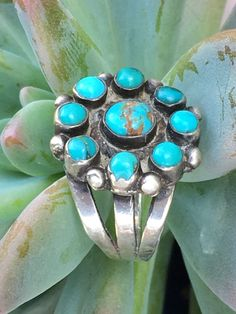 Navajo sterling silver rosette ring set with natural turquoise. Hand wrought shank with a cold chisel split. Size: 5 Measures in diameter. No hallmarks. Acid tested for metal purity. Vintage Turquoise, Turquoise Jewelry, Turquoise Bracelet, Lapis Lazuli, Avery Jewelry, Ambre, Rosettes, Navajo, Bling Bling