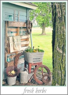 Another view of Lauras wonderful vintage potting shed. Love the jars and feed sacks displayed on the pallet! Its just perfect! Our Prairie Home: Our Little Piece of the Prairie gardens-and-potting-sheds