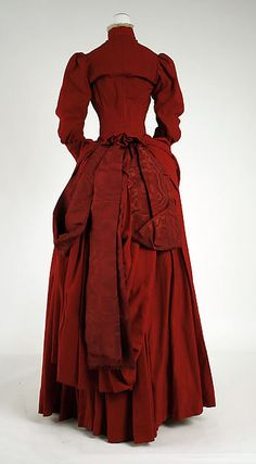 Dress Date: ca. 1887 Culture: American Medium: wool, silk Dimensions: Length at CB (a): 22 in. (55.9 cm) Length at Side Seam (b): 43 7/8 in. (111.4 cm) Credit Line: Gift of Anne L. Maxwell, in memory of her mother, Julia H. Lawrence, 1989 Accession Number: 1989.246.3a, b