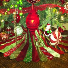 Christmas tree skirt made out of neckties. This may be even cooler than the tie purse!