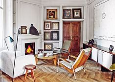 Miquel Alzueta's passion for European mid-century design is evident in his Barcelona living room. Pieces by French creators Jean Royère, Jean Prouvé, Serge Mouille and Charlotte Perriand