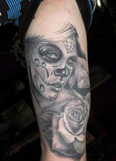 Grey ink day of the dead tattoo on arm