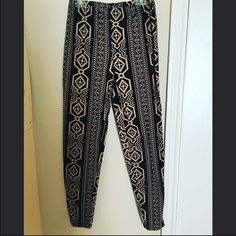 Tribal leggings Black and brownish-nude tribal print Forever 21 leggings! So comfy! I liked them a lot but unfortunately they fit too big on me! But I bet they're perfect fitting for someone else out there!  Forever 21 Pants Leggings