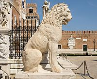 The First lion standing at the left side of the Door land the Arsenal of Venice is ancient Greek sculpture, originally at the Piraeus in Athens, brought to Venice by Francesco Morosini, who conquered the Peloponnesus.