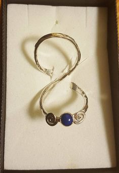 Swan neck silver hammered ring splint with Lazili lapis