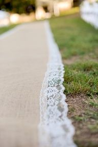 burlap  lace aisle runner , maybe a pretty ribbon the colors of the wedding instead?