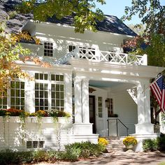 The front facade in the fall. 🍁#landschuteliving #front #facade #entry #fallcolors #autumn #minnesota #historichome #renovation #restoration #midwestmoment #beautifulhomesofinstagram #bigwhitehouse #mums #flowerboxes #architecturelovers #architecture #architect #builder #charminghome #timeless #design #homestyle #frontelevation #originaldesign #lakehouse #landscape