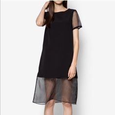 Bottom sheer chiffon dress Black organza-paneled midi t-shirt dress. Size s, but it is a loose fit. I normally wear S to M, more M. It fits size s to m F21 Dresses Midi