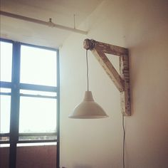 We made our desk lamp out of an old wood support beam and an ikea light.
