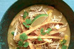 This version of tortilla soup arises from a dish served at the Rose Garden restaurant in Anthony, Tex. We've streamlined the original recipe, using chicken legs as the base of the stock, pulling off the meat when it's tender, and adding couple of beef bones to give the broth extra depth. Laila Santana, whose mother, Dalila Garcia, owns the Rose Garden, told us the recipe lends itself to improvisation. That it does, so feel free to tweak it to your tastes. (Photo: Yunhee Kim for The New York…