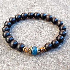 Ebony and blue sapphire jade and tiger's eye guru bead mala bracelet #ebony #black #blue #brown #bracelet #unisex #men #mensjewelry