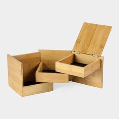 Moma  | This multi-level cube-shaped storage box swivels open to reveal three lined compartments.