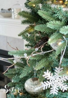 Christmas tree looking a little sparse? Make these decorative twig and pinecone sprays, plus find out other ways to make your Christmas tree look fuller on a budget. #TreeDecorations