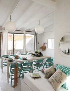 Originally a dark garage, a two-story home is renovated with fresh decor mixing rustic and vintage in El Poblenou, a beach district of Barcelona, Spain. House Of Turquoise, Interior Design Living Room, Interior Decorating, Design Interior, Metal Folding Chairs, Casas Shabby Chic, Deco Addict, Sitges, Piece A Vivre