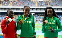 Almaz Ayana of Ethiopia, gold medal, Vivian Jepkemoi Cheruiyot of Kenya, silver medal, and Tirunesh Dibaba of Ethiopia, bronze medal, pose on the podium after the Women's 10,000 metres Final on Day 7 of the Rio 2016 Olympic Games at the Olympic Stadium on August 12, 2016 in Rio de Janeiro, Brazil.